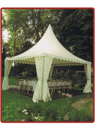 a small marquee with a table chairs