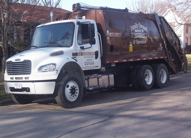 A residential trash hauling truck in Lincoln, NE