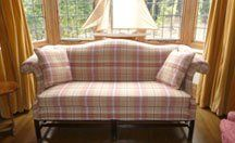 sofa upholstered in muted pink tartan