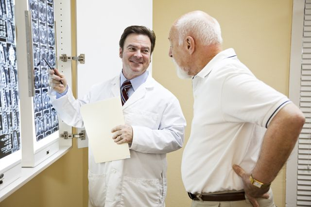 Chiropractor discussing an X-ray with a patient