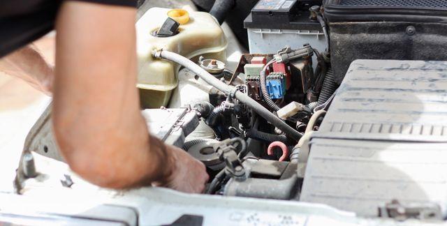 Man repairing Car engine in Wisconsin Rapids