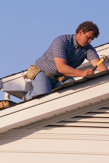 Roofing Contractor Working on Albany NY Home