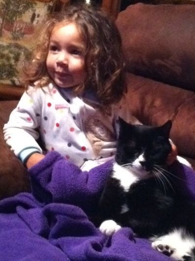 Child and cat on the sofa