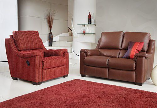 living room with foam sofa and armchair