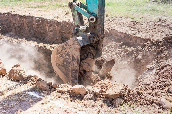 Escavatore in funzionamento