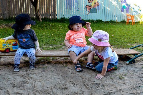 toddlers playing in sand