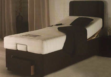 brown based electrically powered bed
