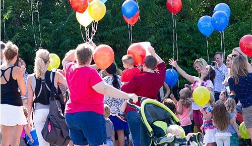 School outdoors activity with balloons in Creve Coeur