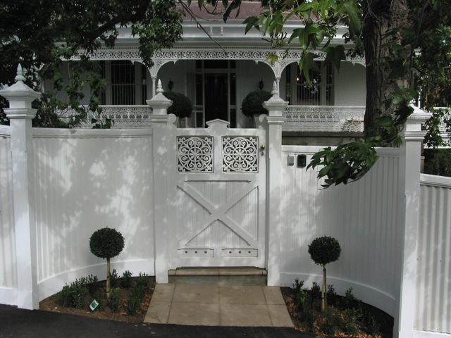 white house with cast ironfencing