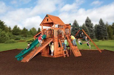 Family enjoying in a playset on rubber mulch