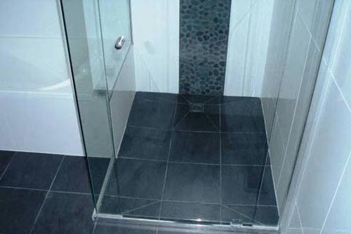 View of the bathroom after installation of tiles