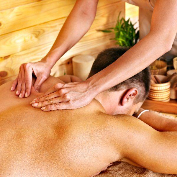 A man's back is massaged in a beautiful salon