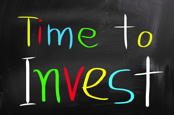 Time to invest written on black board