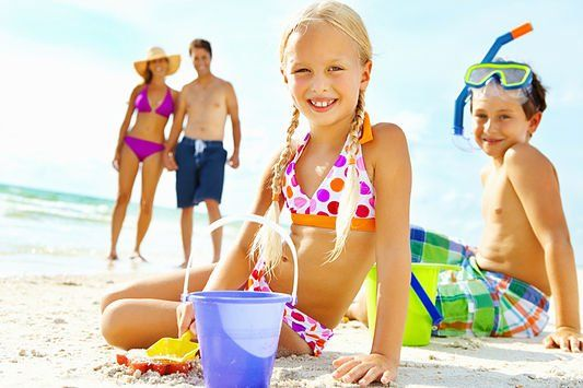 Young children enjoying at the beach