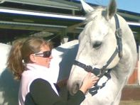 Our biomechanics specialist Raph Kennedy with a horse in the Southern Highlands