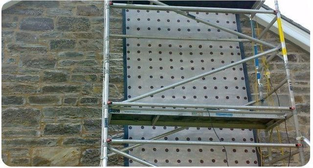 waterproofed stone wall with a membrane