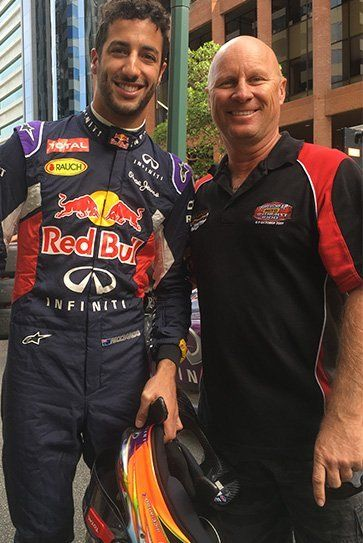 smiling formula one driver with fan