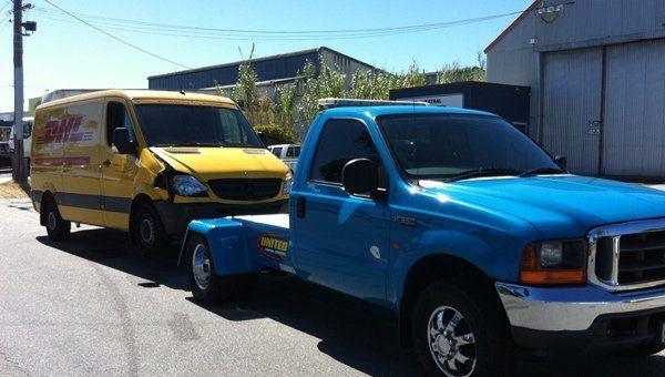 wheel lift tow truck towing van