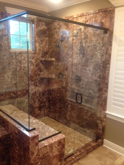 A member of an experienced glass replacement team in Orange Beach, AL