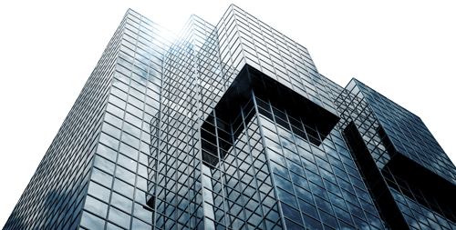 Corporate building with light reflecting off the top glass windows