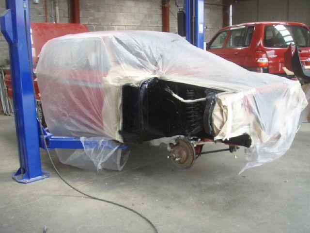 Car under repair in garage
