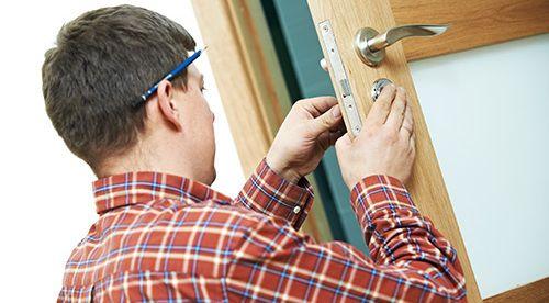 Expert working on lock to ensure safety in Caro, MI