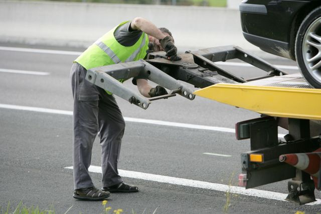 Tow truck operator at work in Auckland