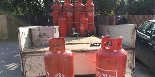 a bunch of gas bottles