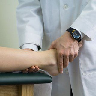 doctor checking a patient with ankle pain
