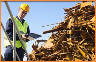 A scrap merchant assessing the scrap metal