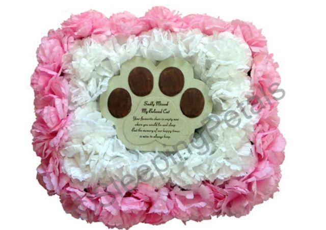 artificial flowers that surround pet memorial plaque