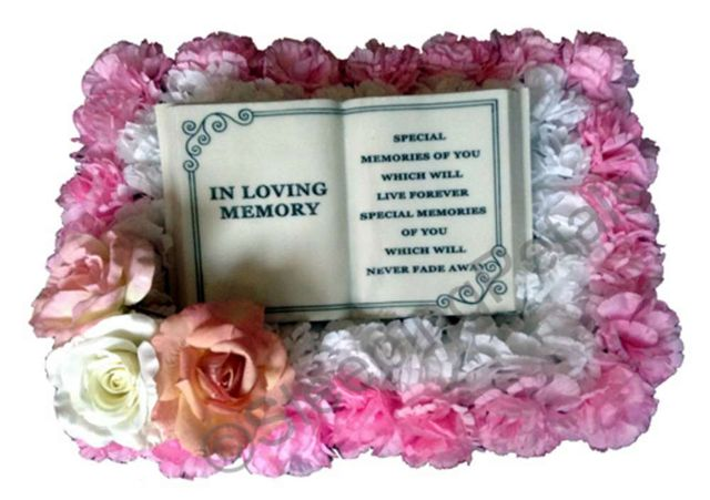 artificial flowers that surround the plaque frame