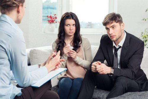 Man and woman having a serious conversation in therapy
