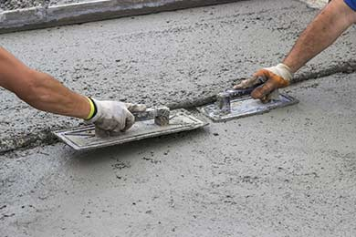 Leveling concrete with trowels