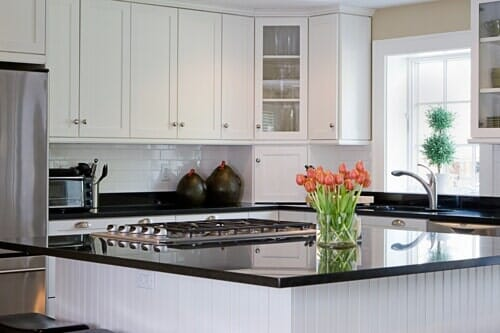 White Cabinet And Black Countertop U2014 Custom Kitchen Cabinets In Sarasota, FL