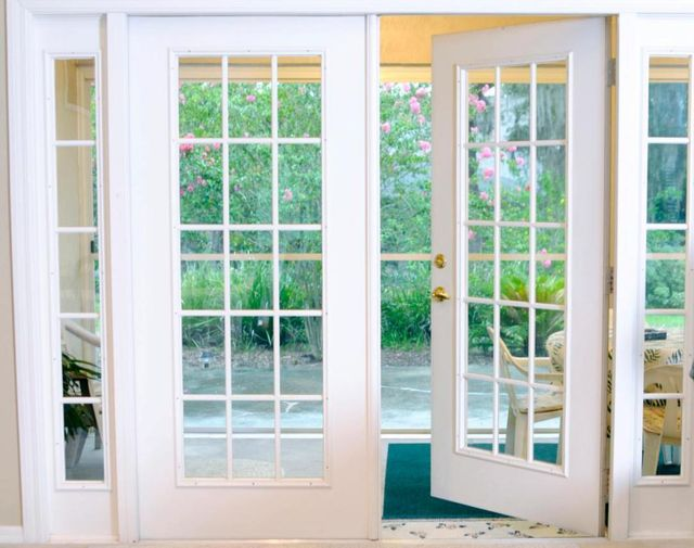 storm french doors at the back of a house