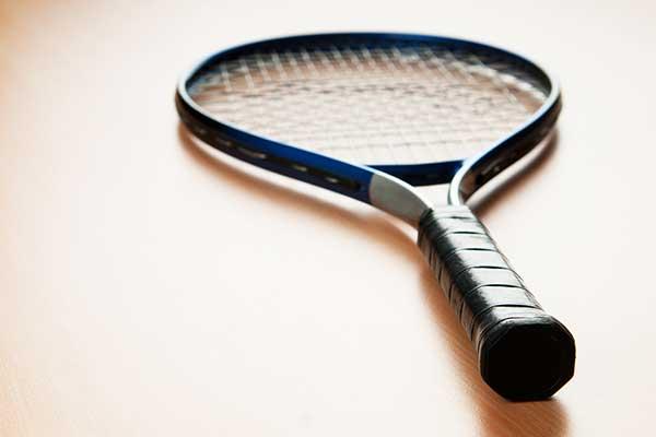 Tennis racket on floor
