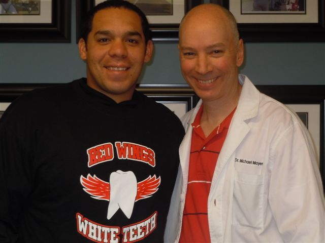 dentists advising client on teeth replacement in Fairport, NY