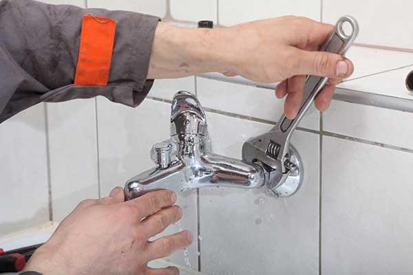 Plumber repairing the tap