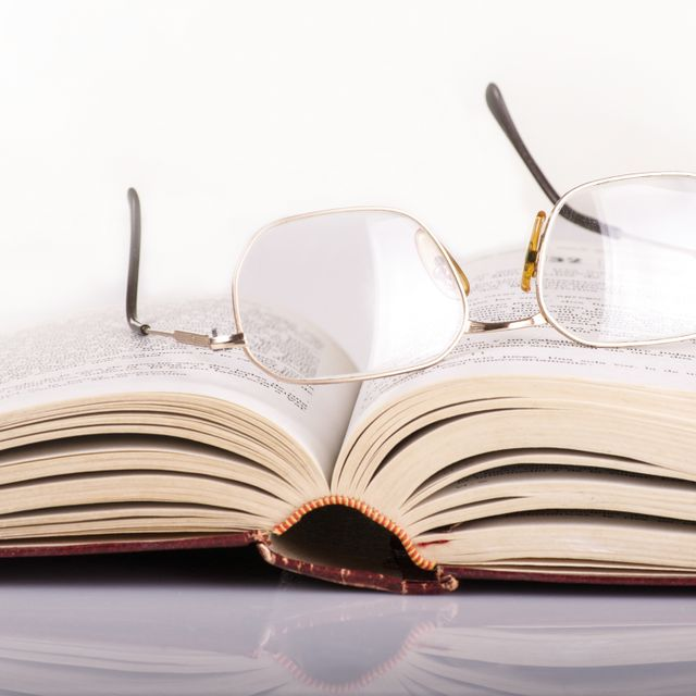 Law book with glasses