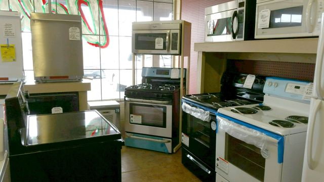 Showroom with stoves, and microwaves.