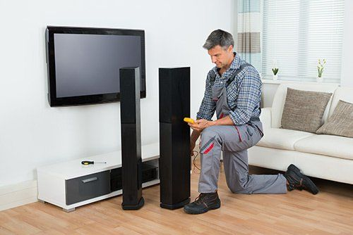 Home theater system being installed by expert