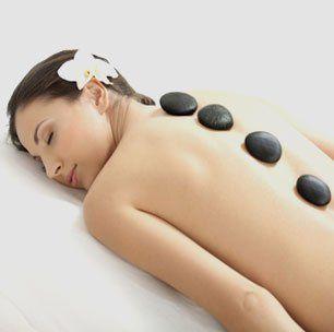 A woman getting a hot stone massage