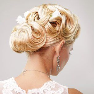A woman with her hair made up for a wedding