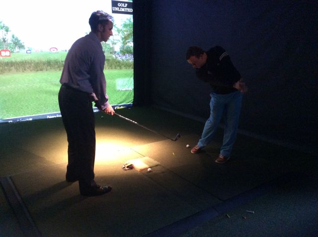 Golf lesson in our indoor golf simulator in Yorkshire