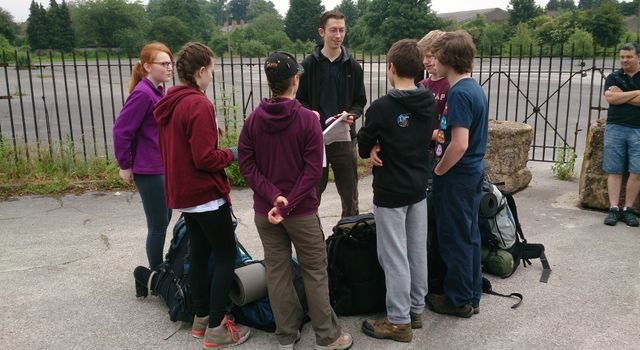 Students discussing about the life-changing adventure