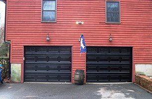 Garage Door Installation U2014 Closed Up Black Garage Door In Hartford, CT