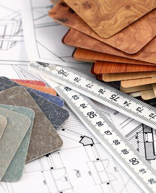 surface samples and measuring tape on house plans