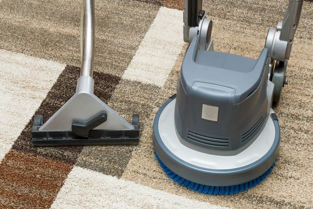 View of a professional doing the carpet cleaning