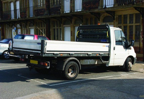 A pick up truck in a town centre car park
